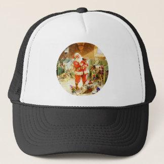 Weihnachtsmann u. seine Elfe an seinen Truckerkappe