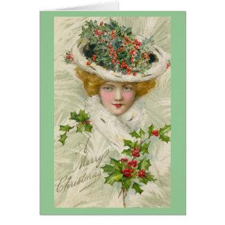 Weihnachtsviktorianische Dame, die einen Sprig der Karte
