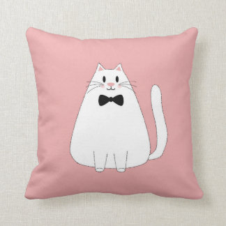 Weiße Katze auf Rosa Kissen