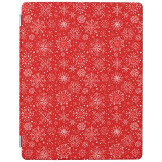 Weiße Schneeflocken auf Weihnachtsrot iPad Hülle