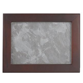 Weiße Tinte auf silbernem Hintergrund Erinnerungsdose