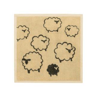 Weiße u. schwarze Schafe auf Sahnehintergrund Holzdruck