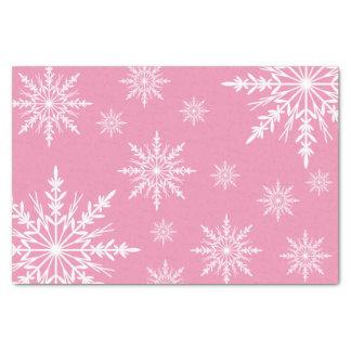 Weiße Winter-Schneeflocken auf Rosa Seidenpapier