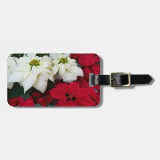 Weißer und roter Weihnachtsfeiertag der Gepäckanhänger