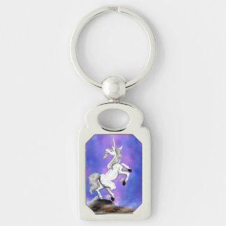 weißer Unicorn stehend auf einem Felsen Schlüsselanhänger