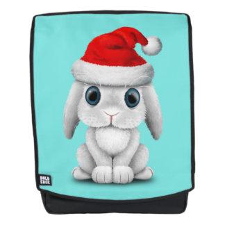 Weißes Baby-Häschen, das eine Weihnachtsmannmütze Rucksack