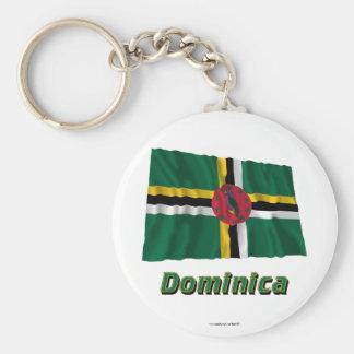 Wellenartig bewegende Flagge Dominicas mit Namen Standard Runder Schlüsselanhänger