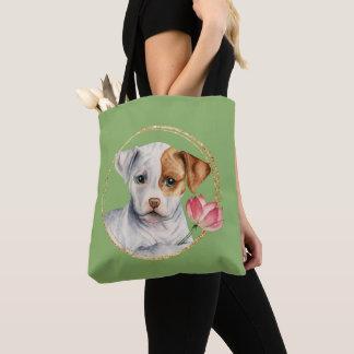 Welpe, der Lotos-Blume mit Imitat-Goldring hält Tasche