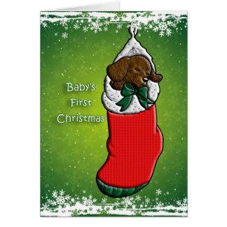 Welpen-Hund des Babys erster Weihnachtsim Strumpf Karte