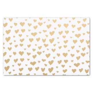 Wenig Goldherzen auf Schneewittchen-Hintergrund Seidenpapier