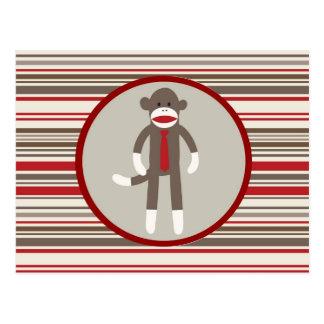 Wie ein Chef-Socken-Affe mit Krawatte auf roten Postkarte