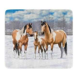 Wildleder-Farben-Pferde im Schnee Schneidebrett