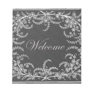 Willkommene Blumen-und Blatt-Tafel Notizblock