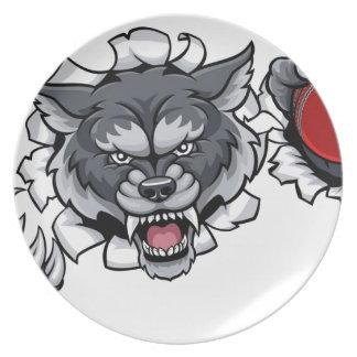 Wolf-Kricket-Maskottchen, das Hintergrund bricht Teller