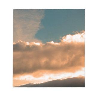 Wolken am Sonnenuntergang Notizblock