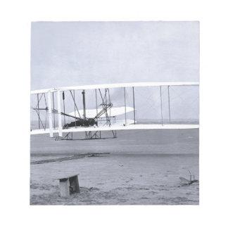 Wright-Bruder-' erster Flugzeug-Flug im Jahre 1903 Notizblock