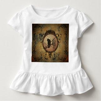 Wunderbarer Vogel in einem Kreis gemacht vom Kleinkind T-shirt