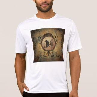 Wunderbarer Vogel in einem Kreis gemacht vom T-Shirt