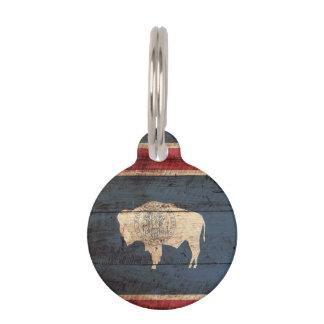 Wyoming-Staats-Flagge auf altem hölzernem Korn Haustiermarke