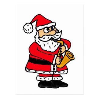 XX lustiger Weihnachtsmann, der das Saxophon Postkarte