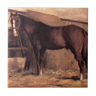 Yerres, rötliches Bucht-Pferd im Stall durch Keramikfliese
