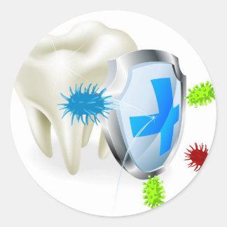 Zahn- und Schildkonzept Sticker