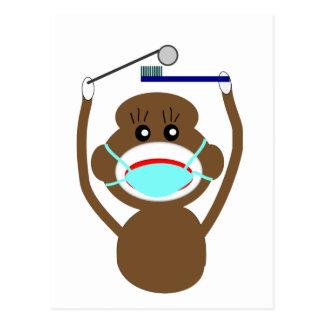 Zahnarzt-Socken-Affe-Shirts und Postkarte