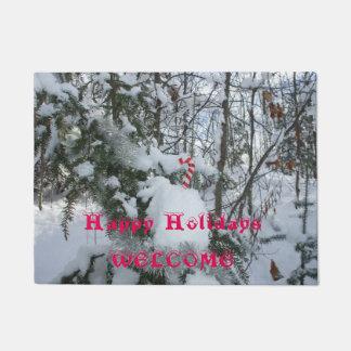 Zuckerstange-Dekoration auf Schnee bedeckte Baum Türmatte