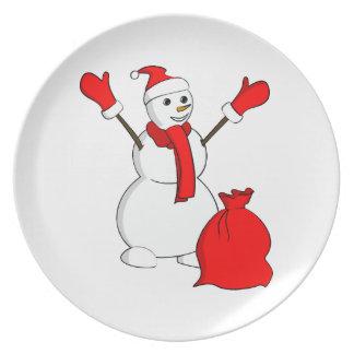 Zujubelnder Schneemann mit der Tasche voll von den Flache Teller