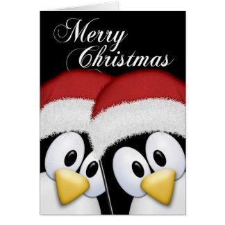 Zwei niedliche WeihnachtssanktPenguins Grußkarte