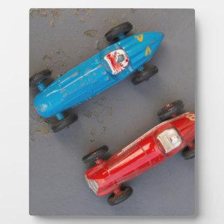 Zwei Vintage Autos des Spielzeugs Fotoplatte