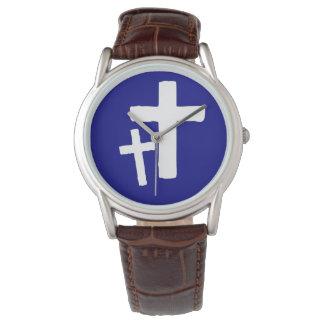 Zwei weiße Quersymbole auf der Uhr der blauen