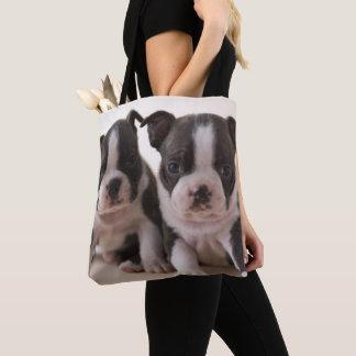 Zwei Welpen Bostons Terrier Tasche