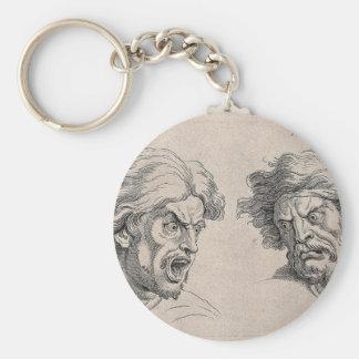 Zwei Zeichnungen der verärgerten Gesichter Schlüsselanhänger